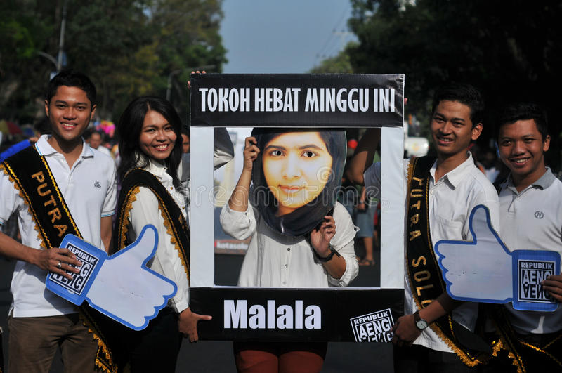An Indonesian activists celebrate Malala Yousafzai Nobel Peace Prize award. SURAKARTA, INDONESIA - October 12 : An Indonesian activist wearing a mask of the 17 stock photo