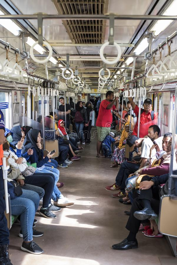 Indonesian commuters take the subway in Jakarta. stock image