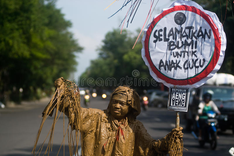 INDONESIAN DEFORESTATION RATE. Sutarno, an environmental activist, posed as a mud man on a protest against deforestation in Solo, Java, Indonesia, April 24 royalty free stock photography