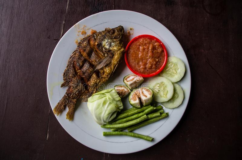 Indonesian dish ikan goreng fried fish.  royalty free stock photography