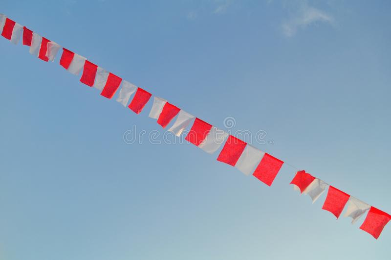 Indonesian flag waving isolated on sky background royalty free stock image