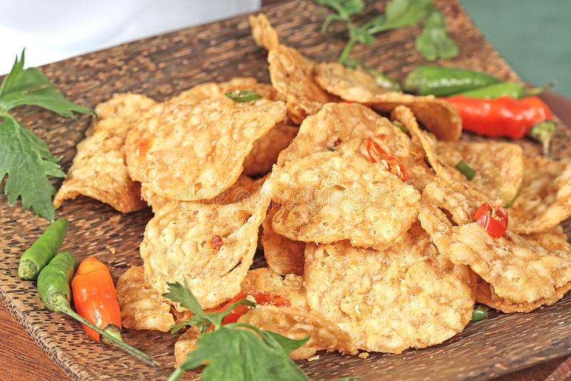 Indonesian food. Crispy, spicy and fried tempeh, Indonesian food stock image