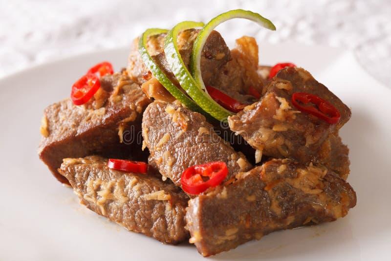 Indonesian Food: Beef rendang close-up. horizontal stock photo
