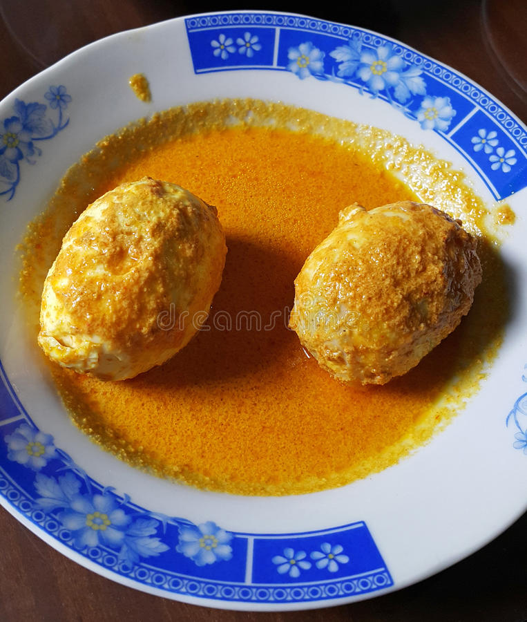 INDONESIAN FOOD GULAI TELUR. One of the most delicious and favourite foods in Indonesia is Nasi Padang, which originates from West Sumatra in Indonesia. This royalty free stock images