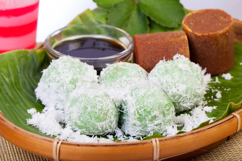 Indonesian Food Klepon with coconut on banana leaf. This food is traditional and popular as Jajanan Pasar stock images