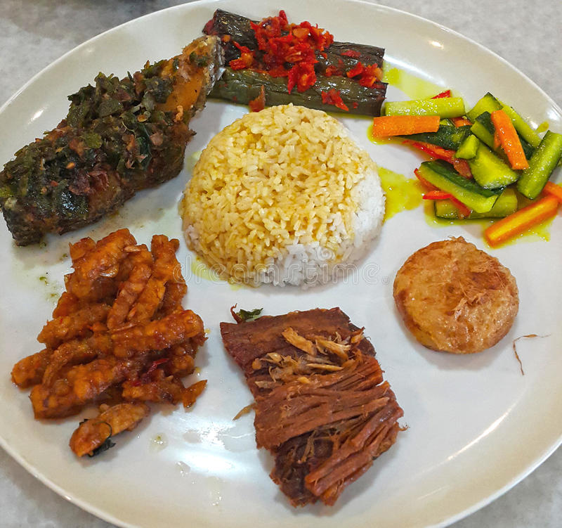 INDONESIAN FOOD NASI CAMPUR. A popular dish in Indonesia is Nasi Campur mixed rice which consists of an assortment of different meat and vegetable dishes eaten stock images