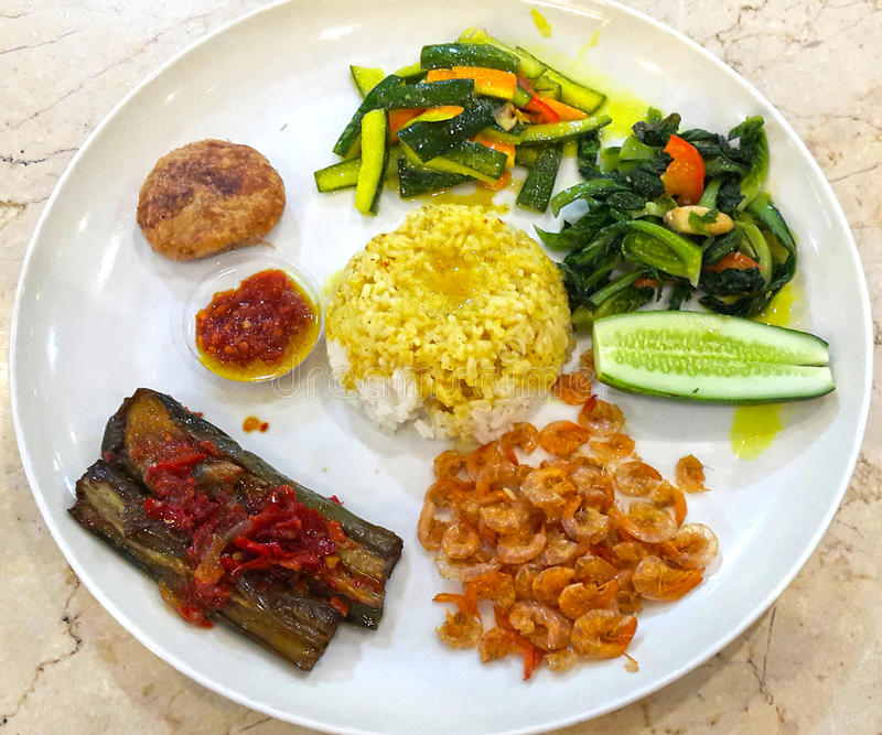 INDONESIAN FOOD NASI CAMPUR. A popular dish in Indonesia is Nasi Campur mixed rice which consists of an assortment of different meat and vegetable dishes eaten stock photography