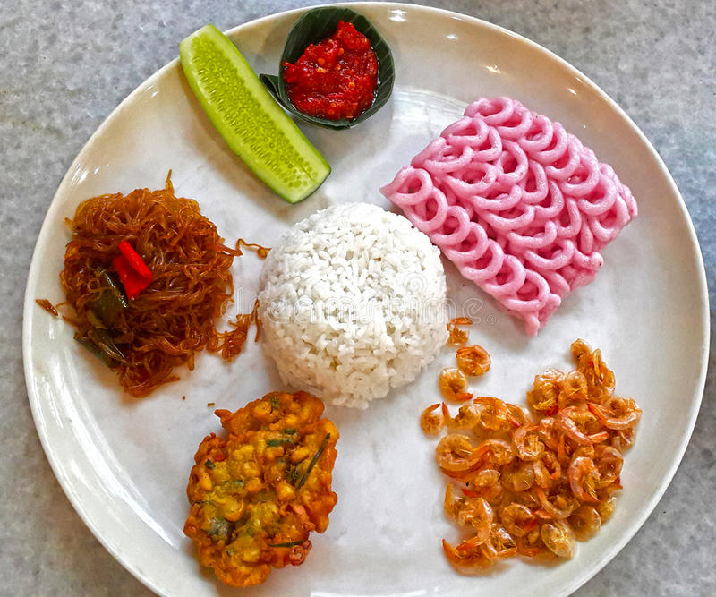 INDONESIAN FOOD NASI CAMPUR. A popular dish in Indonesia is Nasi Campur mixed rice which consists of an assortment of different meat and vegetable dishes eaten royalty free stock images