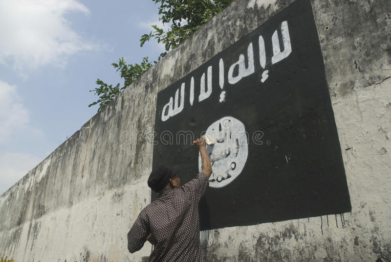 INDONESIAN INTELLIGENCE TO WATCH EXTREMIST GROUP ON ISLAMIC STATE ISSUES. Government officials are erasing graffiti of Islamic State (ISIS) banner in Solo, Java stock images