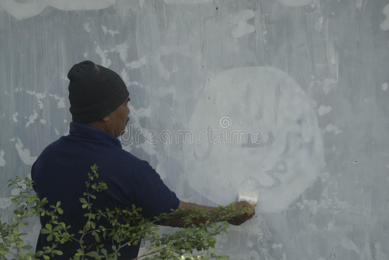 INDONESIAN INTELLIGENCE TO WATCH EXTREMIST GROUP ON ISLAMIC STATE ISSUES. Government officials are erasing graffiti of Islamic State (ISIS) banner in Solo, Java stock image
