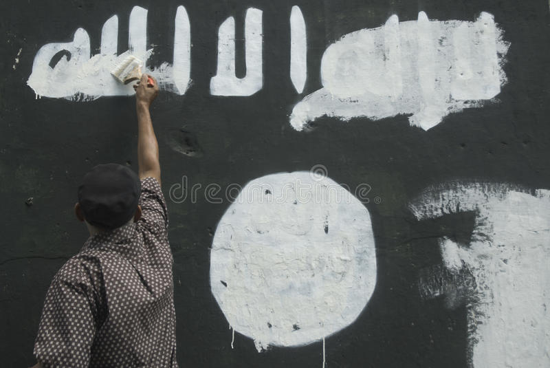 INDONESIAN INTELLIGENCE TO WATCH EXTREMIST GROUP ON ISLAMIC STATE ISSUES. Government officials are erasing graffiti of Islamic State (ISIS) banner in Solo, Java royalty free stock images