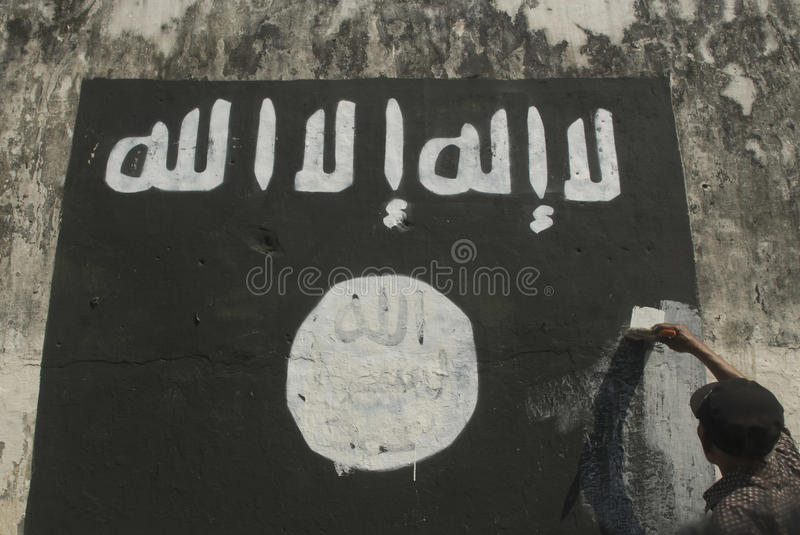 INDONESIAN INTELLIGENCE TO WATCH EXTREMIST GROUP ON ISLAMIC STATE ISSUES. Government officials are erasing graffiti of Islamic State (ISIS) banner in Solo, Java stock photos