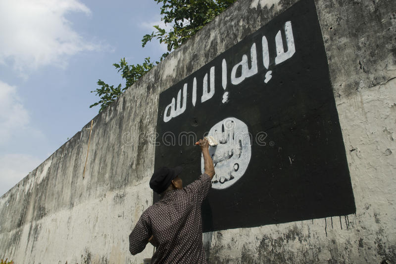 INDONESIAN INTELLIGENCE TO WATCH EXTREMIST GROUP ON ISLAMIC STATE ISSUES. Government officials are erasing graffiti of Islamic State (ISIS) banner in Solo, Java stock photography