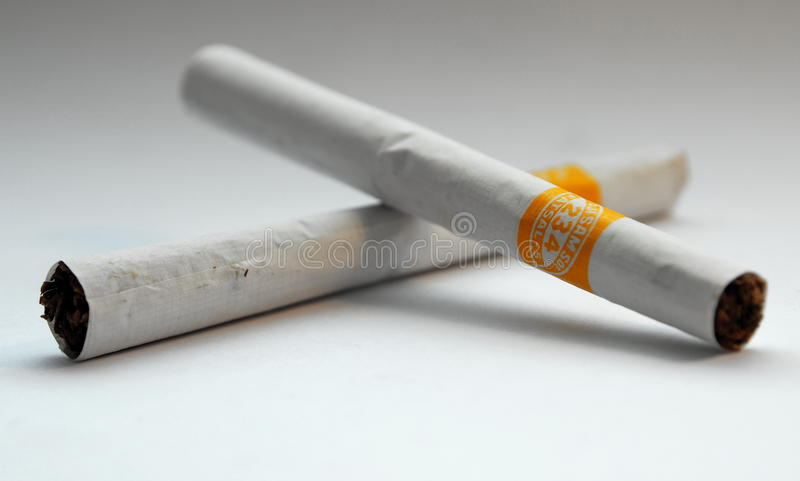 Indonesian Kretek Cigarettes. Some kind of kretek (clove) cigarettes which is typical for Indonesia. Handmade and half clove, half tobacco royalty free stock image