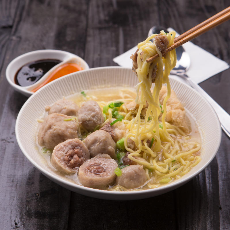 Indonesian Meatball Bakso Noodle with sweet soy sauce and chilli sauce sprinkle with green onion royalty free stock photos