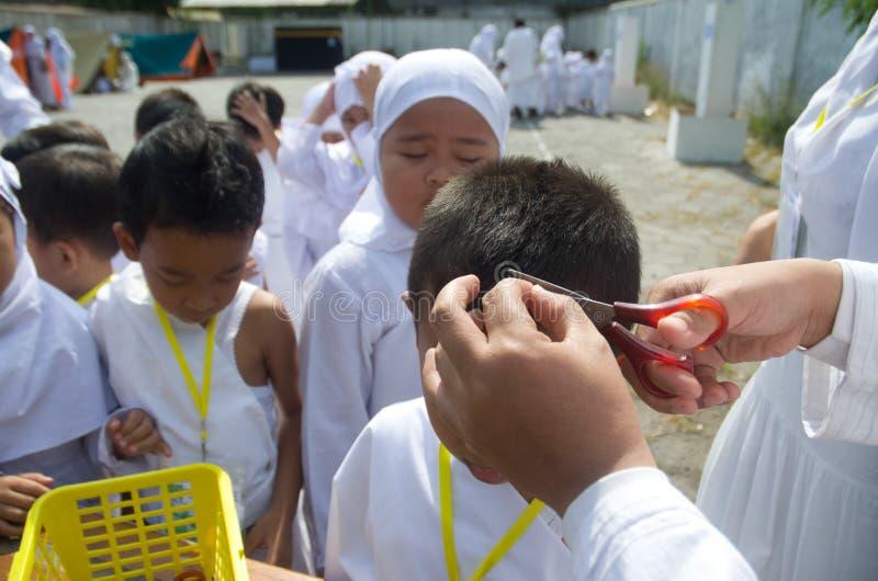 INDONESIAN MUSLIM CHILDREN HAJJ PILGRIMAGE TRAINING stock photos
