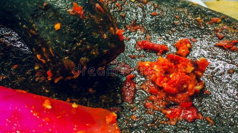 Sambal traditional food of Indonesian. Indonesian sambal, traditional Indonesian food that is so spicy but delicious. made from chili, garlic, kencur and royalty free stock photography