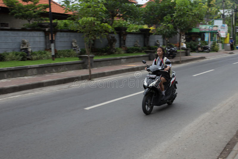 Indonesian school girl motorcyclists stock photos