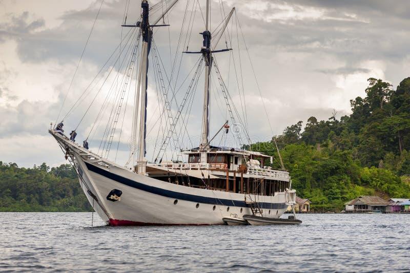 Indonesian Schooner anchored in Raja Ampat, Misool Island, West Papua stock photography