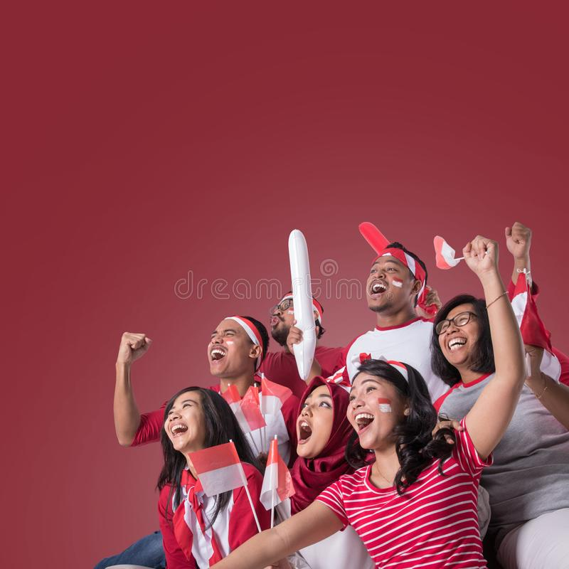 Indonesian supporter watching with excitement stock photo