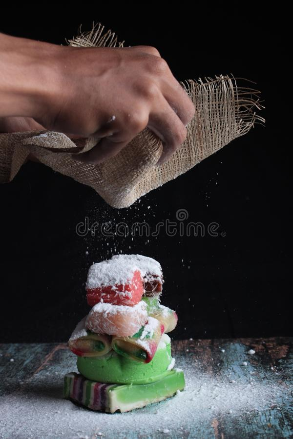 Indonesian sweet cake snacks with a sprinkling of powdered sugar. Typical Indonesian traditional snacks with various variations royalty free stock photo