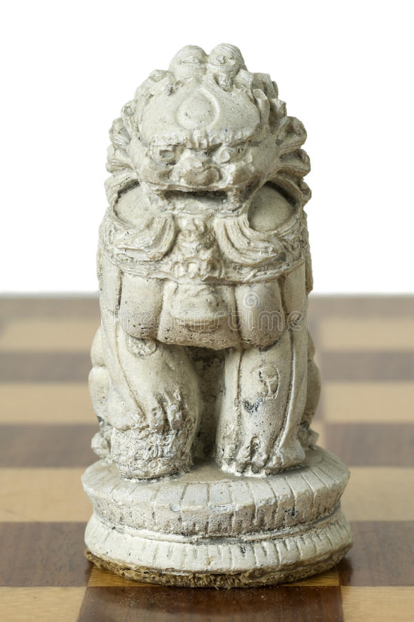 Indonesian Terracotta Chessmen. On the Chessboard royalty free stock images