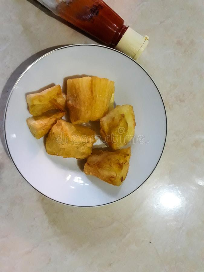 Indonesian traditional food. fried cassava and spicy sauce royalty free stock images