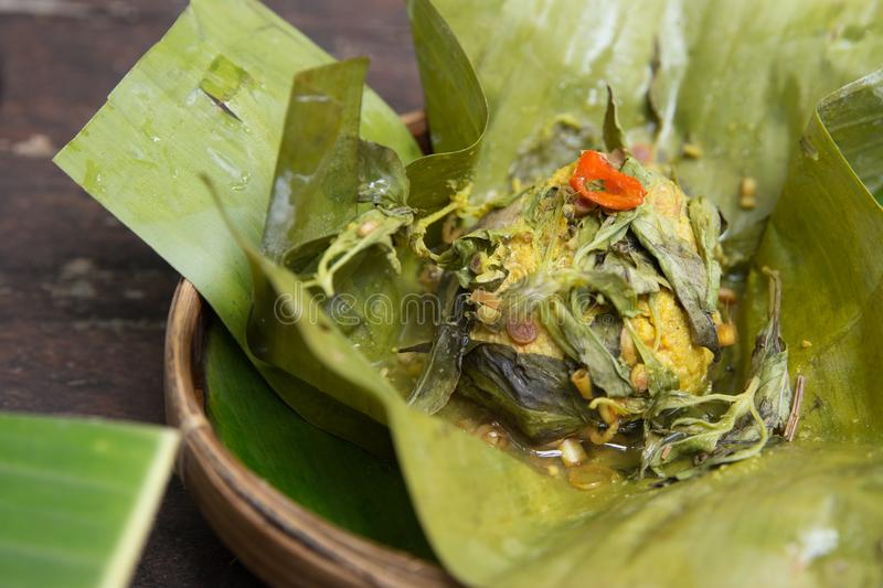 Indonesian traditional food. pepes. Indonesian traditional food of fish or chicken steamed with banana leaf. pepes stock photography