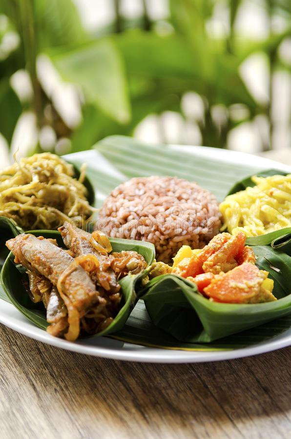 Indonesian vegetarian food in bali. Indonesian food in bali, several curries and rice royalty free stock image