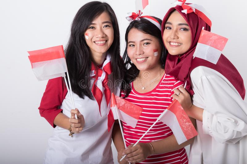 Indonesian woman with flag celebrating independence day royalty free stock image