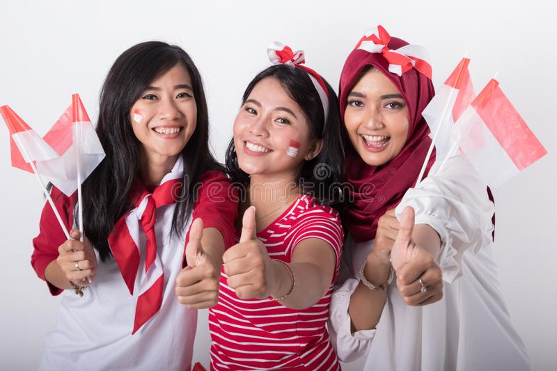 Indonesian woman with flag celebrating independence day royalty free stock images