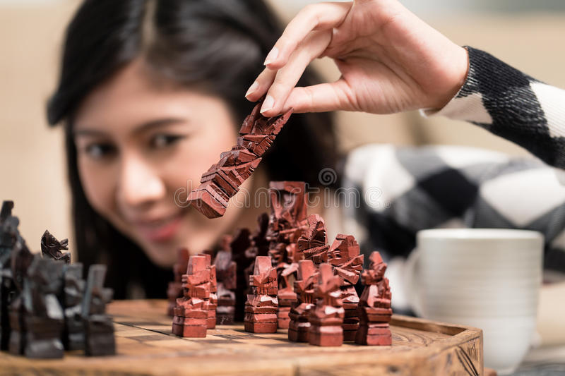 Indonesian woman playing chess setting figure stock images