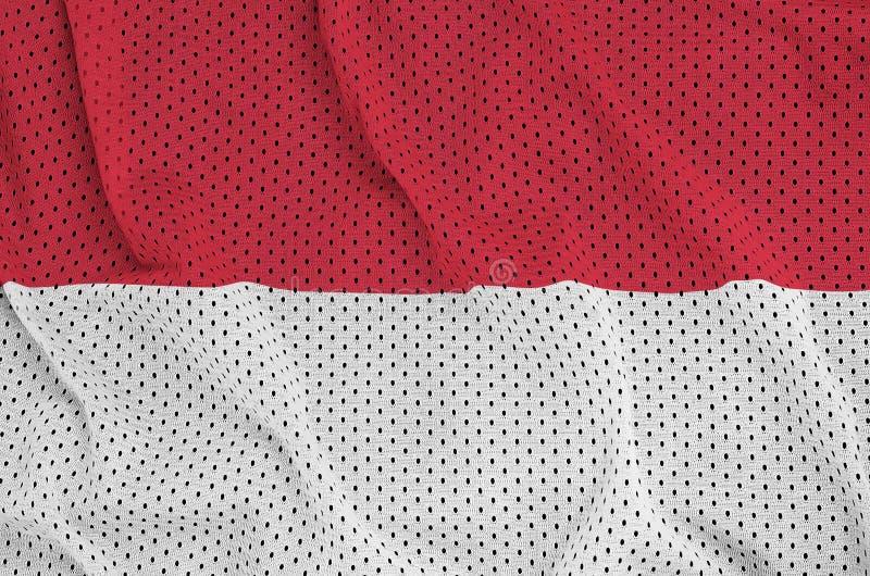 Indonesien flagga som skrivs ut på en fabr för ingrepp för polyesternylonsportswear arkivfoton