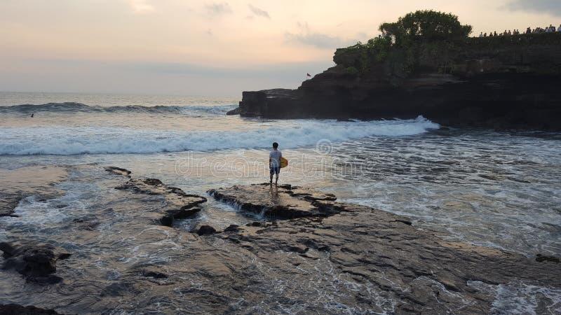 Indonesische surfer stock afbeelding