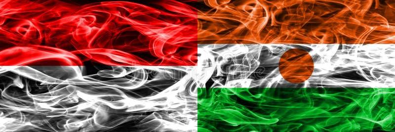 Indonezja vs Niger dymu flaga umieszczająca strona strona - obok - Gęsty colore obrazy stock