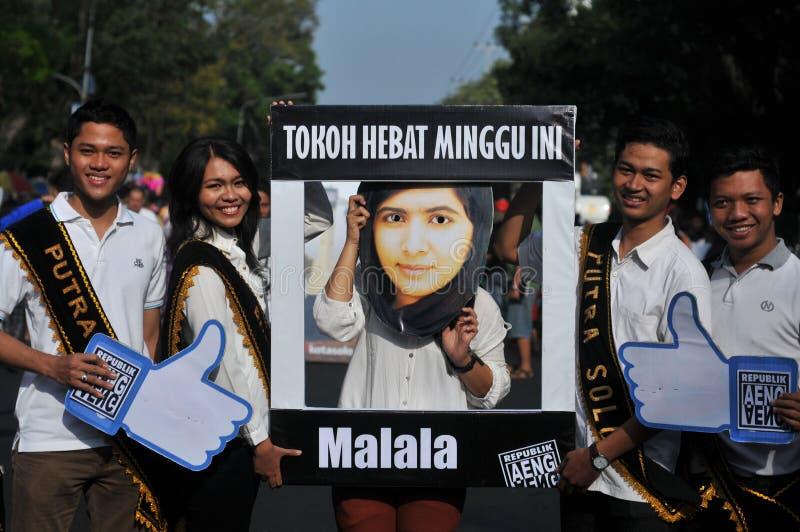 Indonezyjscy aktywiści świętują Malala Yousafzai pokojowej nagrody nobla nagrodę zdjęcie stock