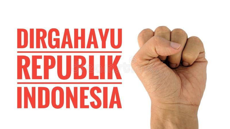 Indonezyjski dzień niepodległości, ręki pojęcie z Indonezyjskim językowym tekstem zdjęcia royalty free