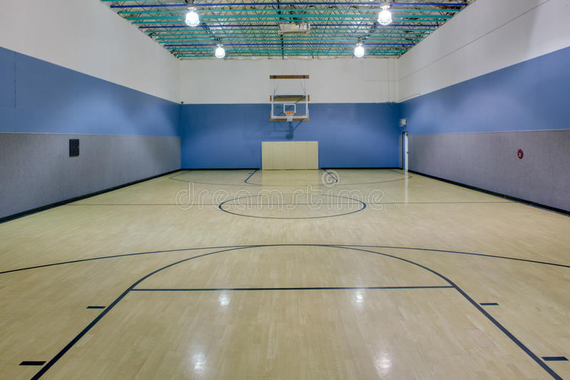Indoor basketball court. Indoor hardwood basketball court, as typically found in a gym stock photos