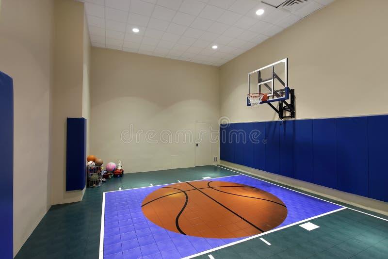 Indoor basketball court in home. Large indoor basketball court in luxury home stock image