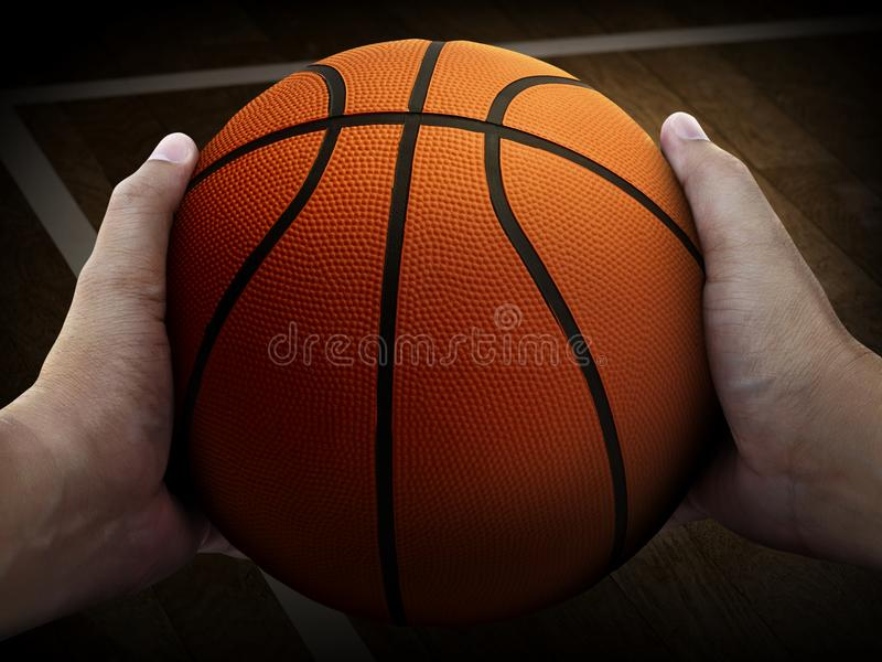 An indoor basketball court with an orange ball on an floor wooden. For design In the media royalty free stock images