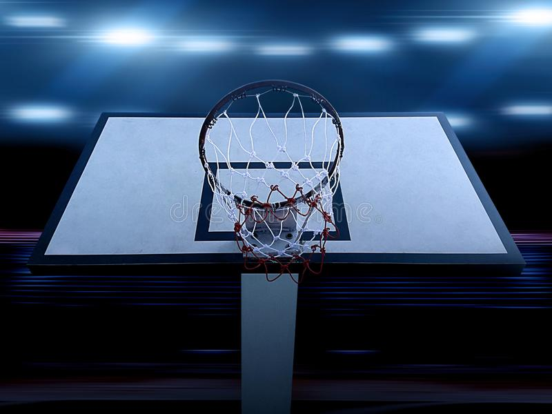 An indoor basketball court with an orange ball on an unmarked wooden floor under illuminated floodlights. For design In the media stock photos