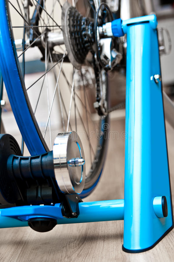 Indoor bike trainer. Detail of professional indoor bike trainer. Rear wheel with magnetic resistance rotor royalty free stock photo