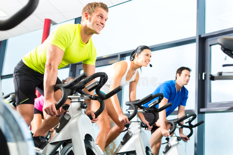 Indoor bycicle cycling in gym royalty free stock images