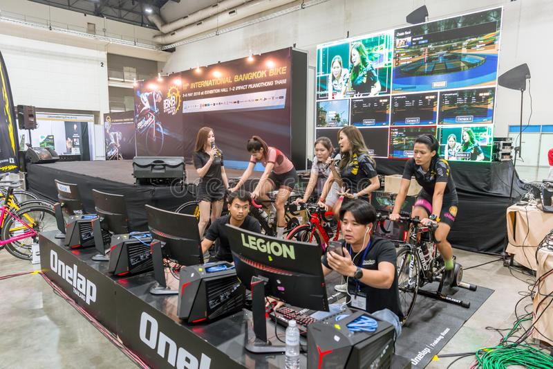 Indoor cycling racing online game computer race show in International Bangkok Bike 2018 bike expo fair royalty free stock photos