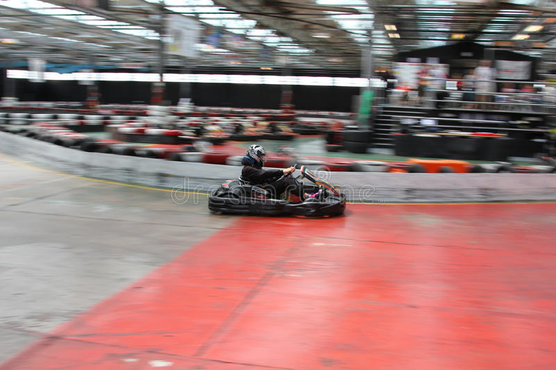 Indoor go karting. A race at an indoor karting circuit royalty free stock photo