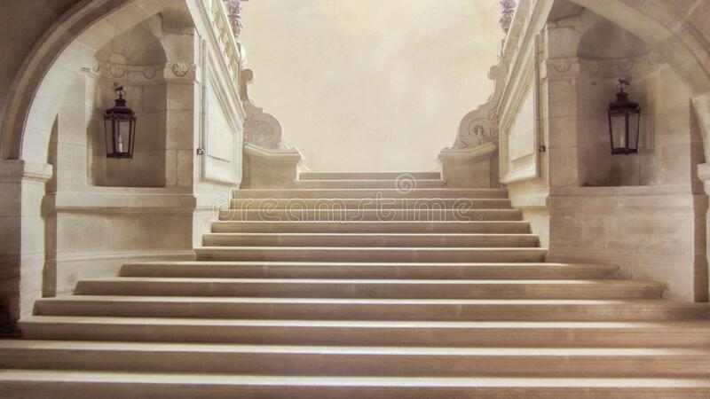 Indoor impressive staircase of an ancient royal palace stock image