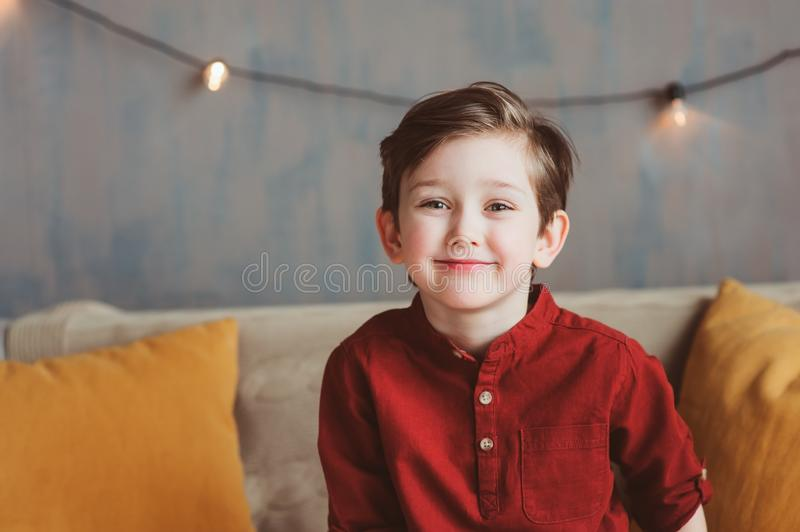 Lifestyle portrait of handsome thoughtful child boy royalty free stock image