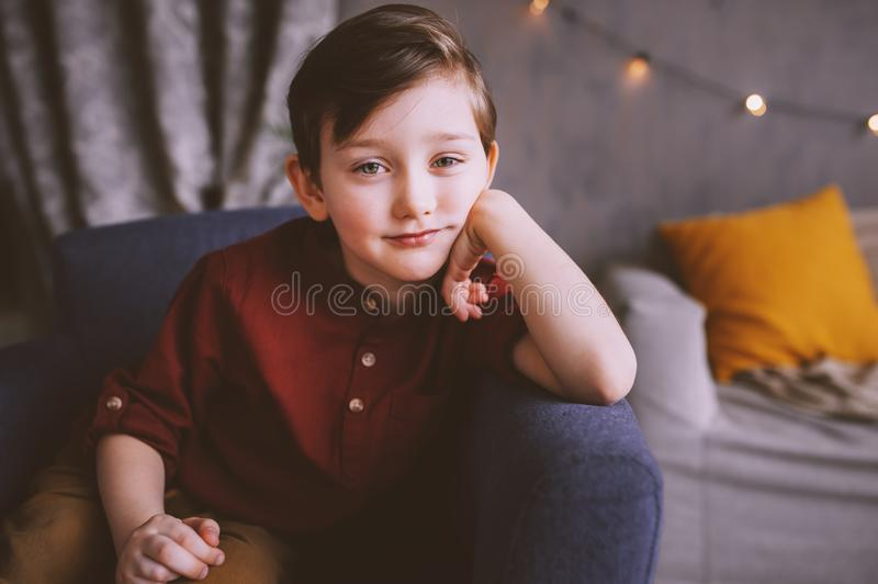 Lifestyle portrait of handsome thoughtful child boy stock images