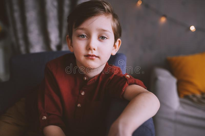 Lifestyle portrait of handsome thoughtful child boy stock photos