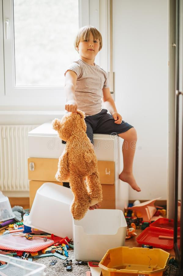 Portrait of a child playing in a very messy room royalty free stock images